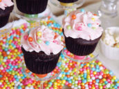 girly rainbow sixlet topped chocolate cupcakes with pink frosting