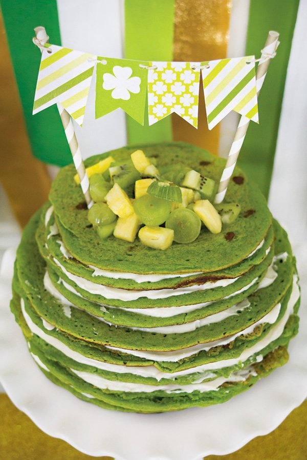 green spinach pancakes stacked for a st. patrick's day brunch