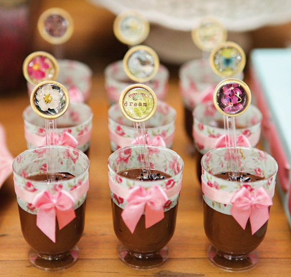 mini chocolate puddings with flower and butterfly spoons