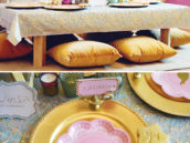 moroccan low table with pillow seats with pink and gold place settings