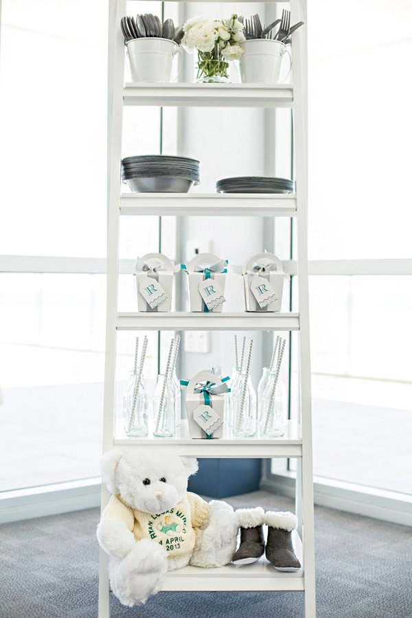 party hutch with glass milk bottles, party favor boxes, plates and utensils for guests