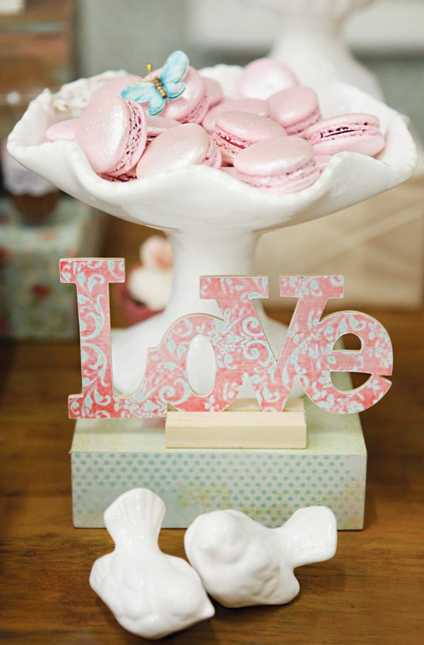 pink pearly macarons and white ceramic love birds