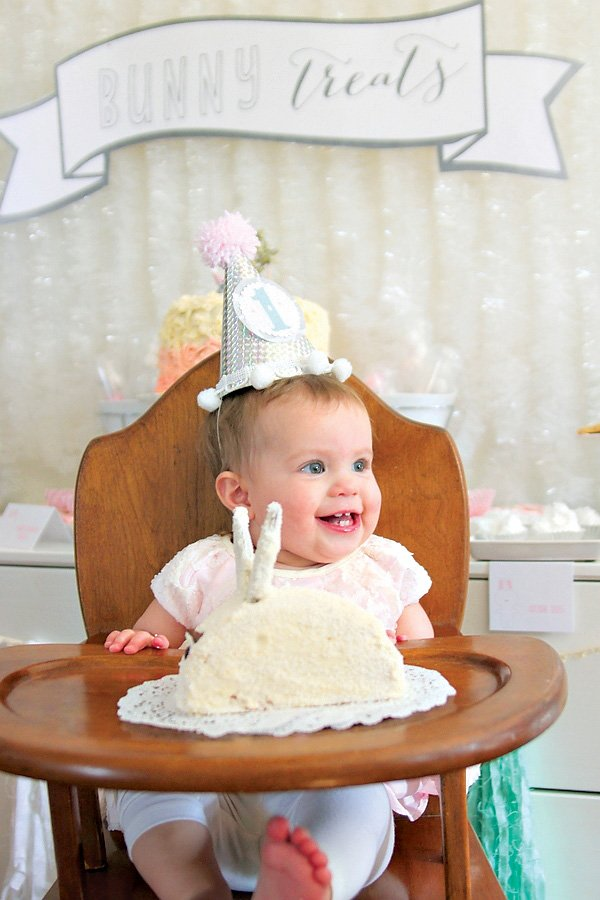 rabbit or bunny themed first birthday smash cake and birthday girl in high chair