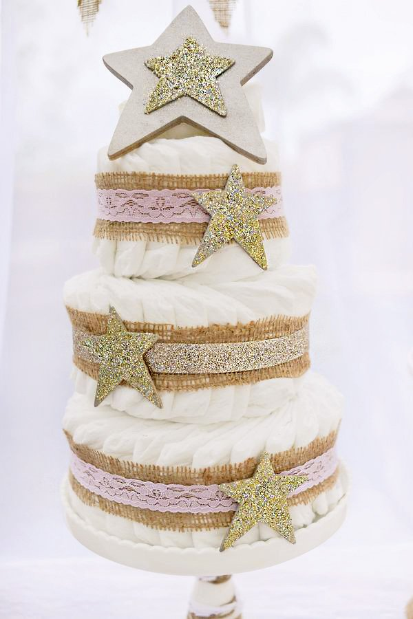 golden star topped diaper cake
