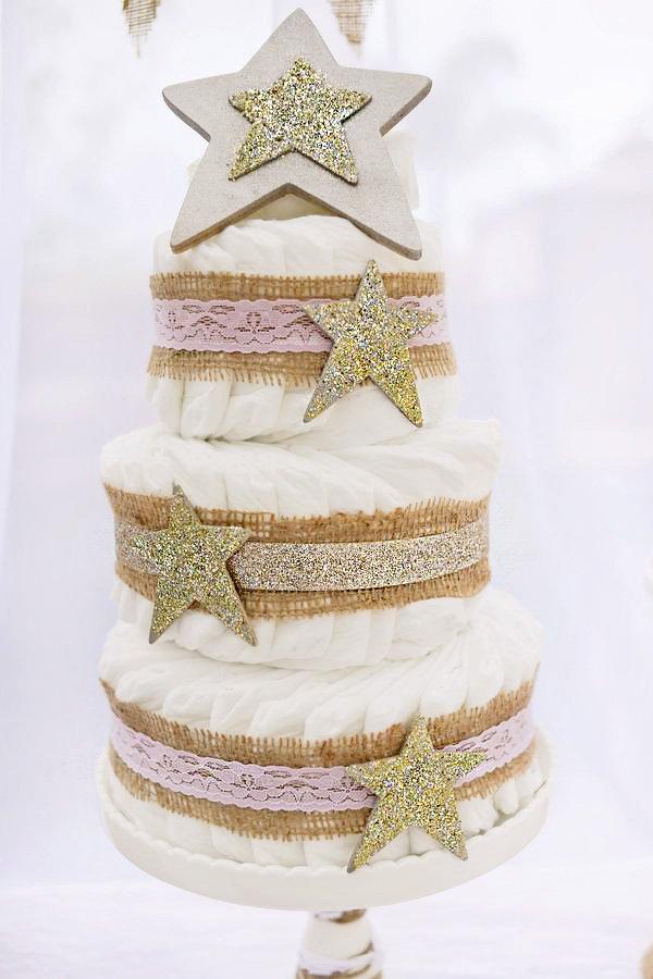 golden star topped diaper cake
