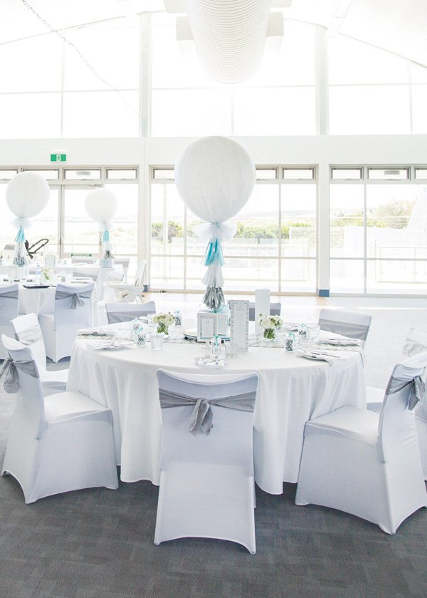 white and silver tablescape with balloon centerpiece
