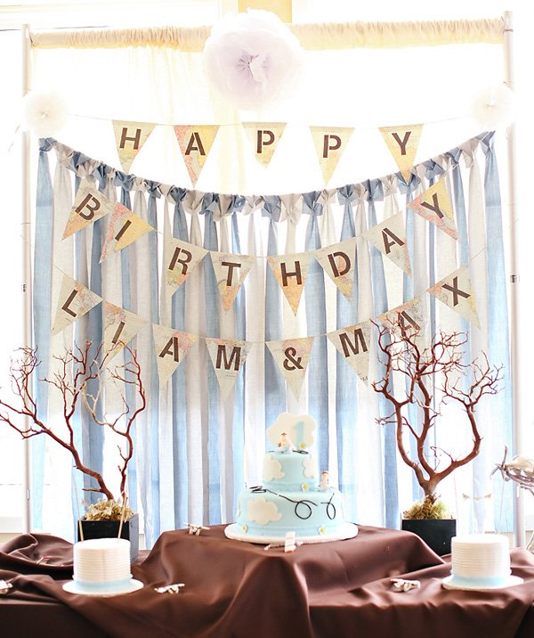travel themed twins first birthday party dessert table