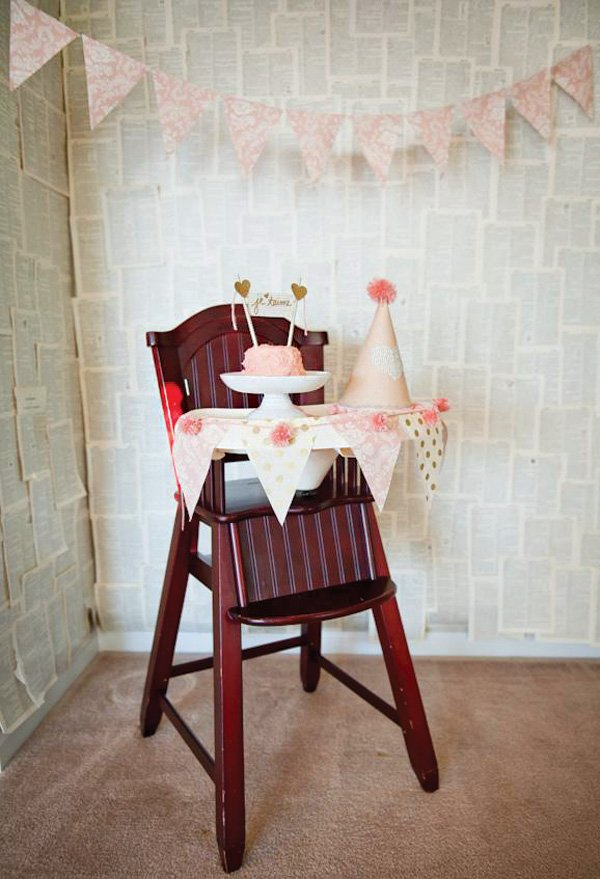 birthday high chair decorations with a book pages backdrop
