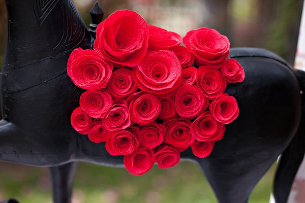 close up of red crepe paper roses