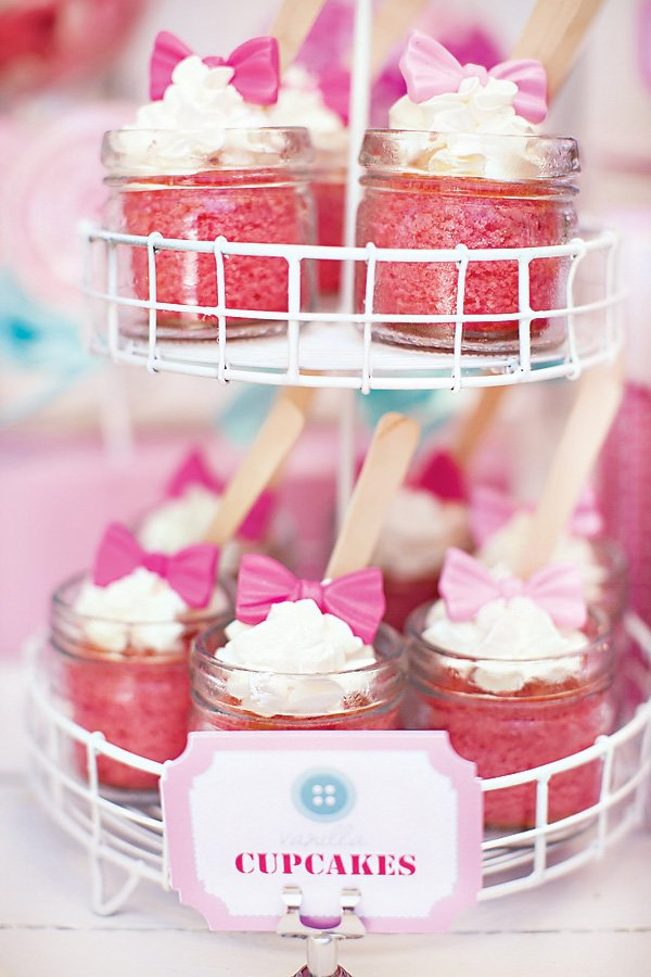 pink cupcakes in mason jars