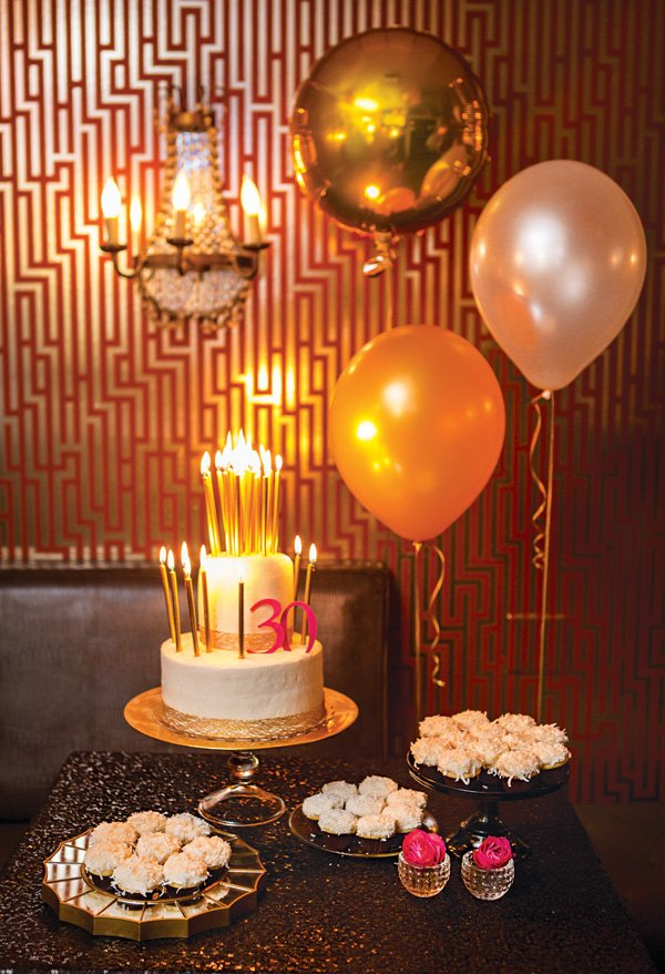 black, gold and white 30th birthday party dessert table