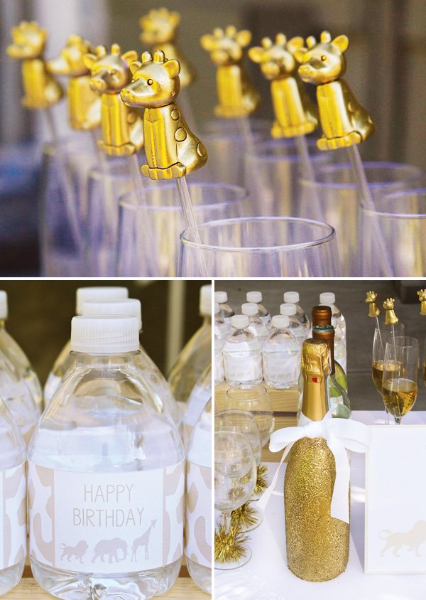 gold giraffe drink stirrers and drinks table