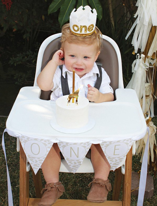 golden first birthday high chair and banner
