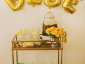 honey flavored baby shower drinks on a vintage bar cart