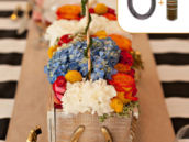 rustic garden party centerpiece with gold horseshoes
