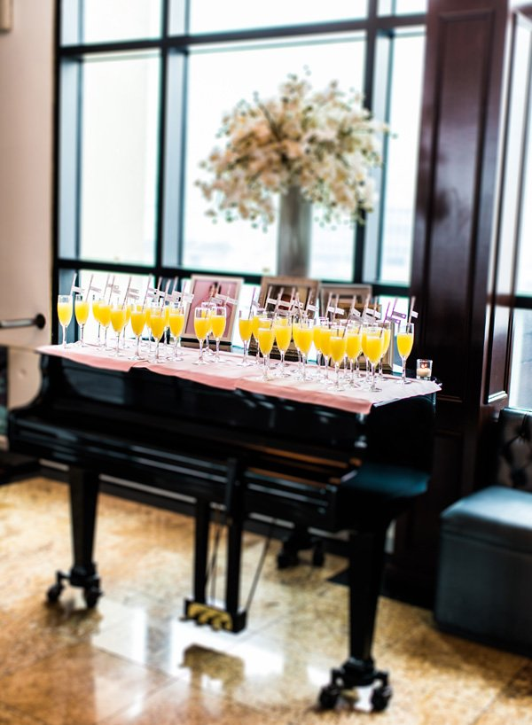 party flag place cards on a piano welcome table