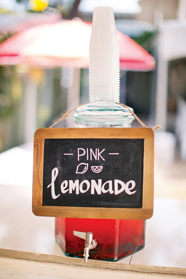 pink lemonade drinks dispenser and chalkboard sign