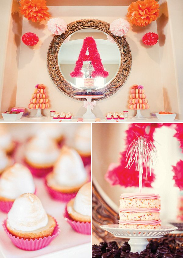pink and orange dessert table with pom garland