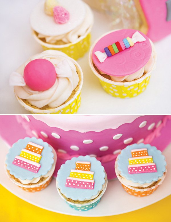 pink and yellow candy and cake topped cupcakes