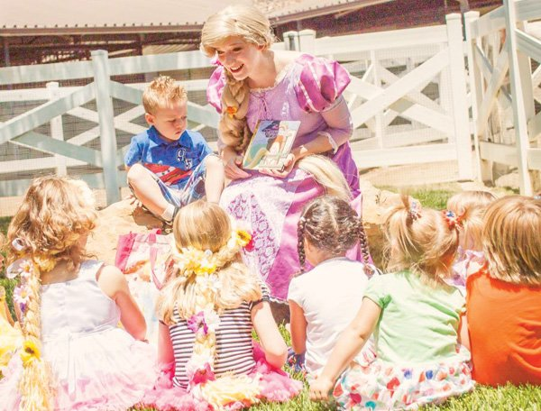 rapunzel reading a story at a birthday party