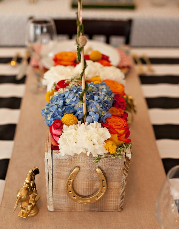 Rustic Garden Party Centerpiece with Gold Horseshoe and Jockey