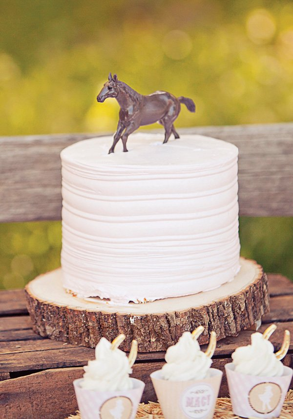 simple pink horse topped birthday cake