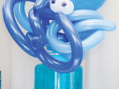 octopus balloon animal topped blue ocean party drink