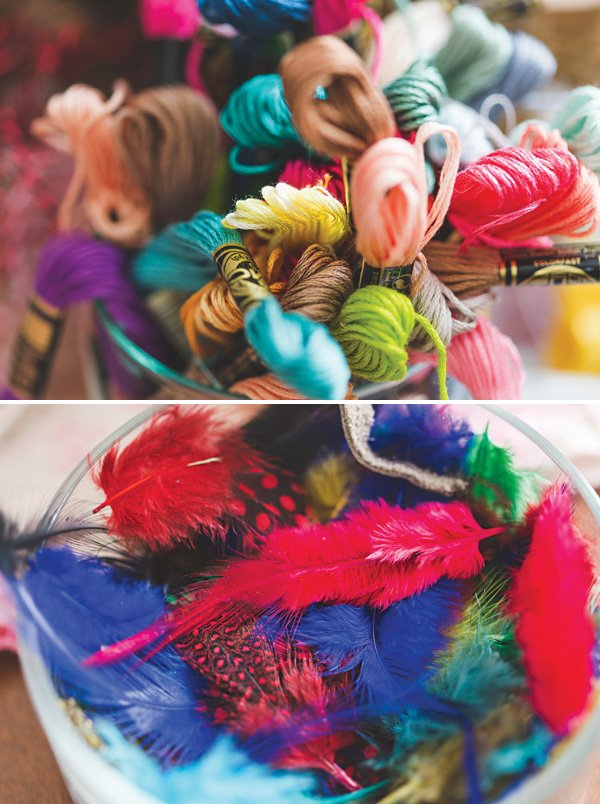 colorful bead and feather crafting supplies