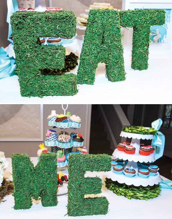garden moss-covered 'eat me' letters
