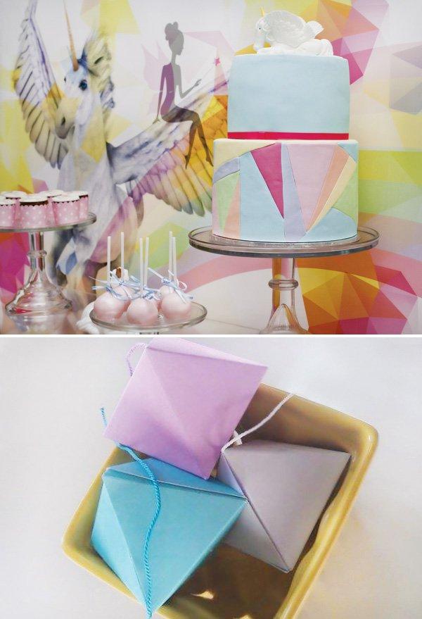 rainbow geometric cake with pegasus topper