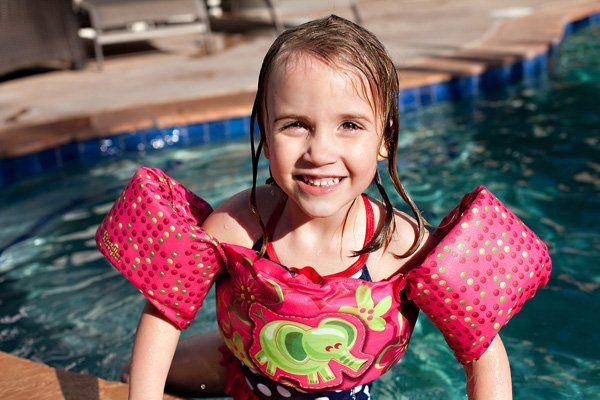 happy kid swimmer at a pool party