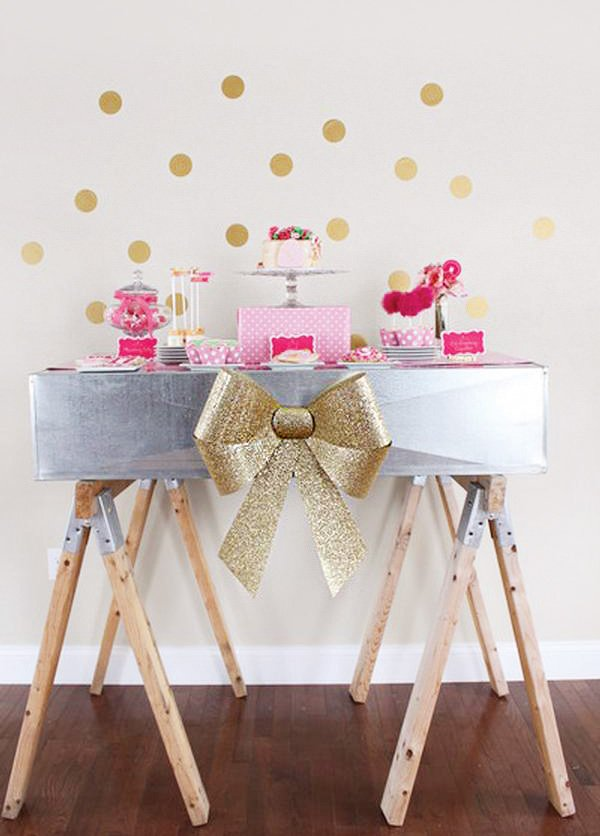 large gold bow decor for a girly dessert table