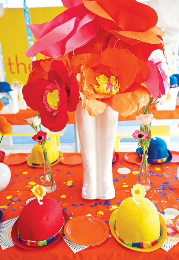 paper flowers in a rain boot vase as the centerpiece