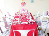 pink birthday party tablescape with pom backdrop