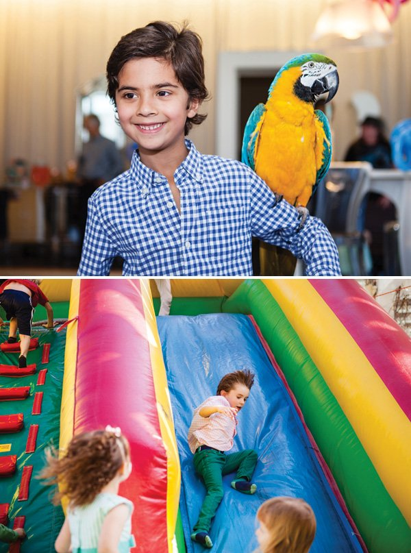 large inflatable slide and pirate parrot visit