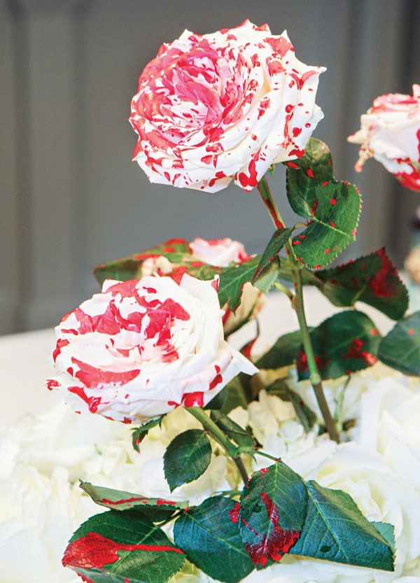 painted red roses for an alice in wonderland party