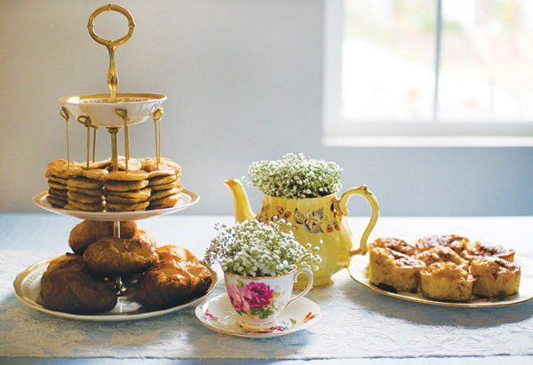 tea party brunch food with tea pot floral vases