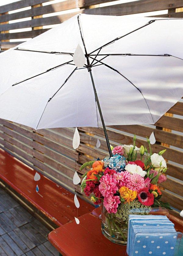 raindrop strung umbrella in a bright floral centerpiece