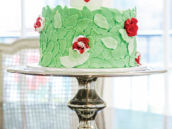wonderland's queen queen of heart's crown topped rose garden cake