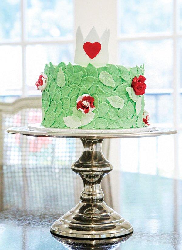wonderland's queen queen of heart's crown topped rose garden cake