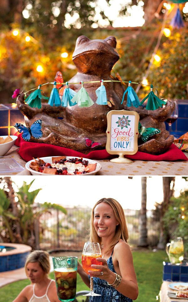 eclectic dinner party with a yoga frog and mini tassel garland