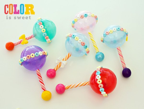 homemade bright colored candy baby rattles for a sweet baby shower