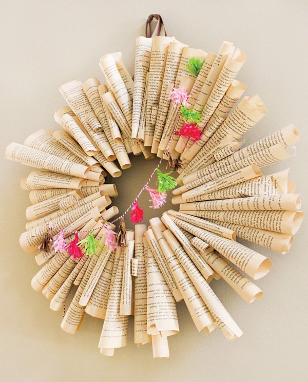 DIY book pages wreath with a mini tassel garland