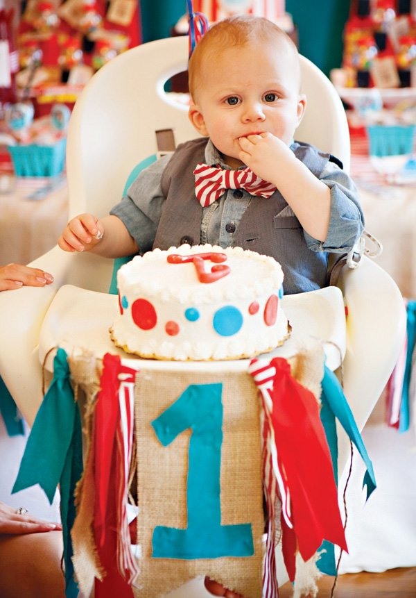 boy's first birthday smash cake and high chair