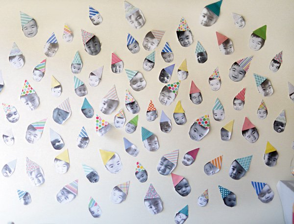 first birthday DIY photo wall with different baby faces