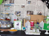 garbage party food table with a recycled newspaper backdrop
