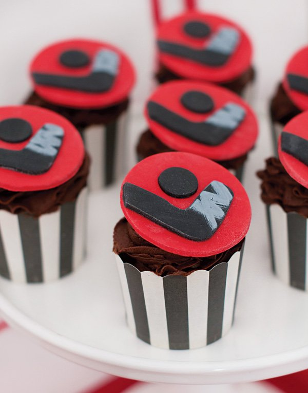 hockey stick and puck topped cupcakes