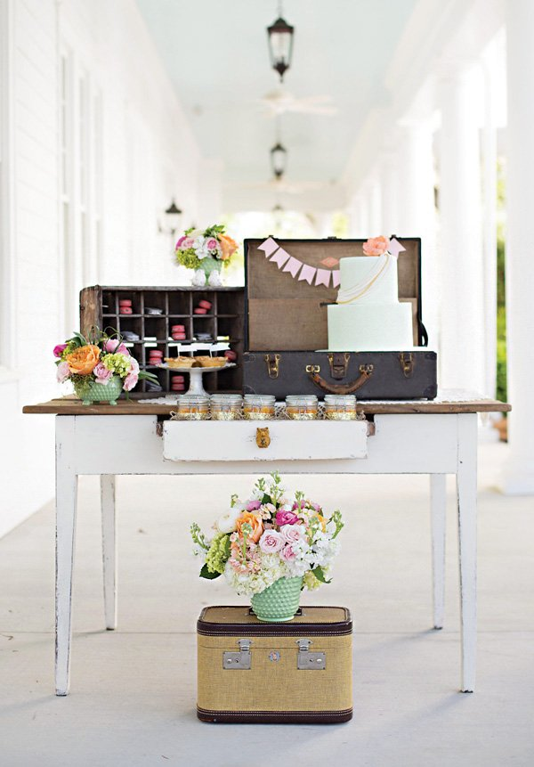 vintage dessert table furniture like suitcases and dressers