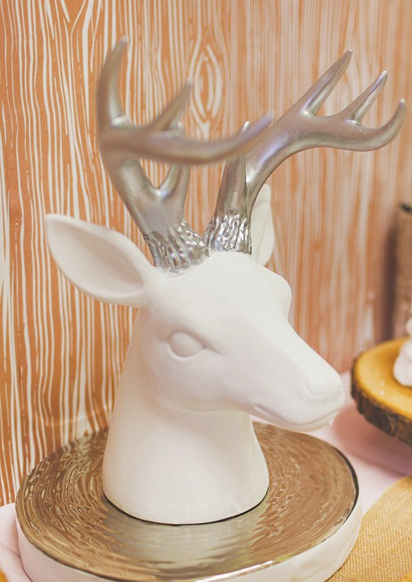 white deer head with silver horns