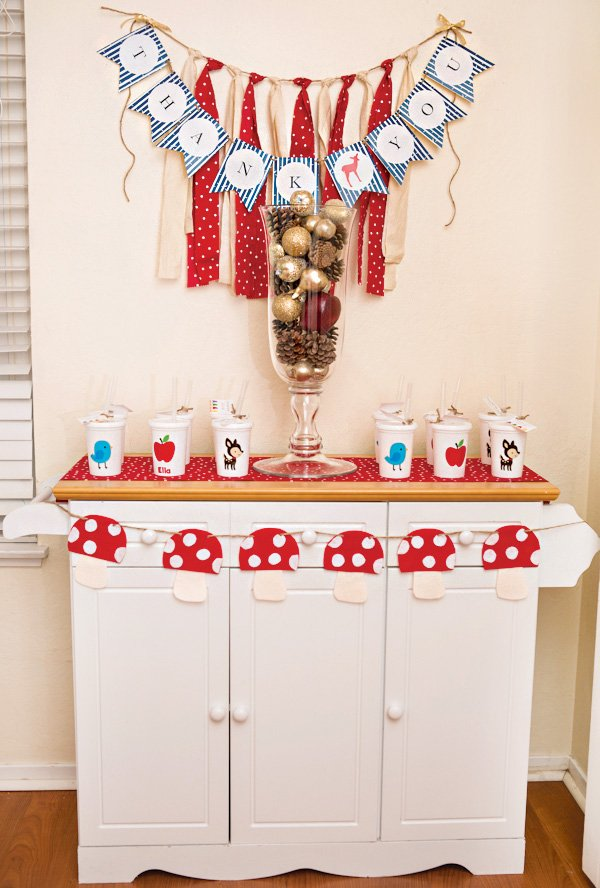 woodland party favor table with toadstool banner
